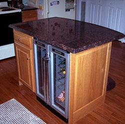 a double door wine cooler built under the counter
