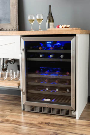 a stainless steel two-zone wine fridge built into under a counter