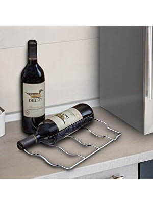 a bottle of red wine lying on the wire shelf of the Nutrichef PKCWC24. the shelf is removed from the cooler and placed on top of a beige counter.