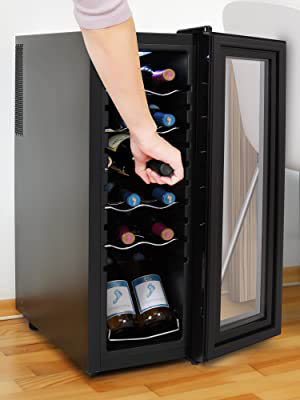We can see as a woman takes out a bottle of wine from the fully stocked Nutrichef 12-bottle fridge