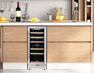 a photo showing the TYLZA 30 bottle wine cooler built-in with beige kitchen cabinetry.