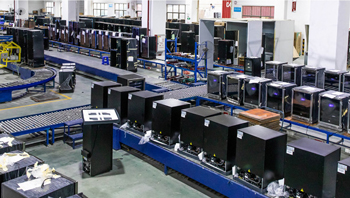 A photo about TYLZA's manufacturing facility. You can see a series of wine fridges on a converyor belt.