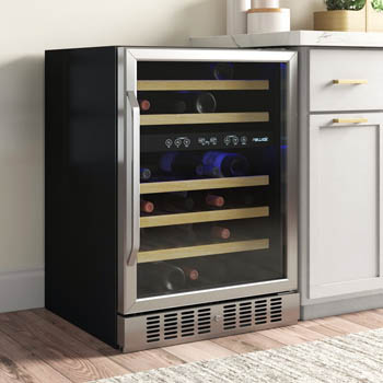 photo of the NewAir NWC046SS01wine cooler with recesssed stainlesss teel kick plat. it is placed next to a white cabinet.